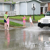 Rod Rose The Lebanon Reporter<br /> A gaggle of little girls, carefully observed by adults, splash in water in the 600 block of Park Street following torrential rains Wednesday.