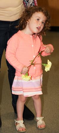 Rod Rose The Lebanon Reporter<br /> FLOWER GIRL: Ashley Jacksonn, flowers in hand, waits for her brother, Tyler, during Lebanon High School's Senior Walk Wednesday.