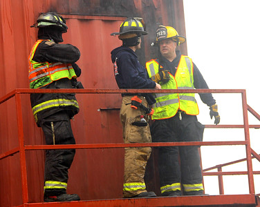 GETTING READY: Instructors stand at the top of the search tower getting ready to send another group through.