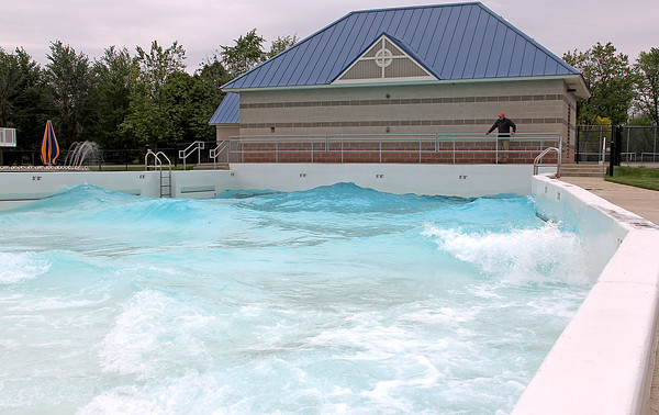 Rod Rose The Lebanon Reporter<br /> STUDYING THE WAVES: Lebanon Parks and Recreation Department employee Todd Janssen inspects the wave pool at Lebanon's Seashore Pool.