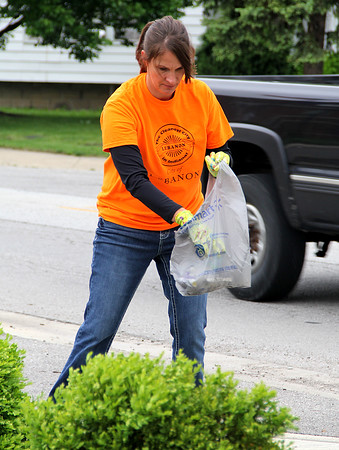 Pick Up, Clean Up<br /> HARD WORK: Lebanon resident, and city employee, Mia Riley picks up trash on Indianapolis Avenue in front of St. Joseph Catholic Church. Riley was part of 19 preregistered teams with over 200 people kicking off the annual Community Clean-Up Days from May 12 to 14. Residents are encouraged to clean-up streets, yards and businesses during this event.