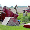 Rod Rose The Lebanon Reporter<br /> RURAL CRASH INJURES ONE: Firefighters from Lizton Fire Department set up booms in a side ditch next to an overturned trailer on state Route 39 at CR 375 S Friday afternoon. A pickup truck pulling the trailer, which was carrying 1,000 gallons of diesel fuel, was involved in a crash with a Honda CRV. The pickup's driver was taken to Witham Hospital, Lebanon, for treatment of unknown but non-life-threatening injuries. Center Township, Brownsburg and Pittsboro fire departments also responded. The crash shortly after 5:15 p.m. closed SR 39 in both directions for hours. Further details were unavailable at press time.