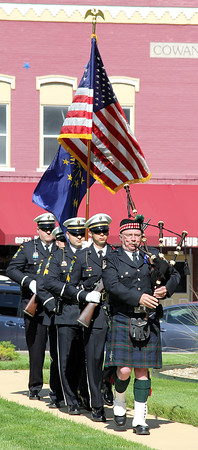 Rod Rose The Lebanon Reporter<br /> PIPING THE GUARD: Piper Mark Wills leads the Zionsville Police Department Color Guard at the beginning of Monday morning's Boone County Police Office Memorial service at the Boone County Courthouse.