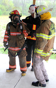SUIT UP: A cadet gets her gear inspected while her chief listens to helpful techniques from one of the HERO instructors.