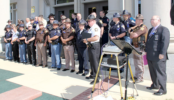 Rod Rose The Lebanon Reporter<br /> HONORING THE FALLEN: Nearly three dozen officers from area law enforcement agencies gathered at the Boone County Courthouse Monday morning to commemorate three officer who were killed in the line of duty.