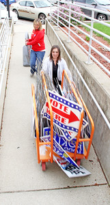 Rod Rose The Lebanon Reporter ELECTION CLEANUP: Boone County deputy clerks Andrea McClaine (at top) and Crystal Schuetz wheel election center signs into storage at the Boone County Courthouse Wednesday afternoon, following Tuesday's record-setting primary election.