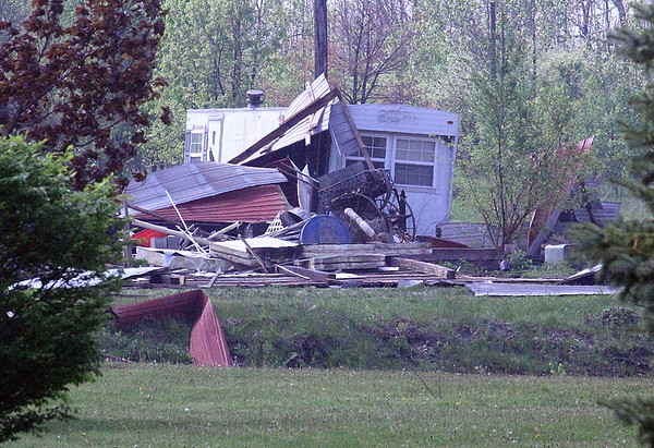 SO CLOSE: A trailer next to the damaged barn escaped major damage despite being side-by-side.