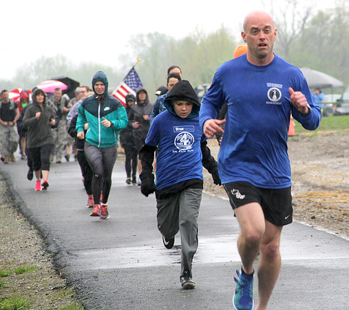 "RAIN OR SHINE: Rain poured down throughout the Witham Hospital 5K Fun Run at the Big 4 Trail Celebration Day on Saturday. By 10 a.m. most of the tents and bounce house were being disassembled as rain looked to persist through the noon hour. ""We had good team effort, but we just lost the game,"" said Friends of Boone County Trails President Dan Warkentien. ""We worked hard to put this together, and everything cooperated except Mother Nature."" Two bike rides, a bike safety workshop, bake sale, and raffle were all scheduled."