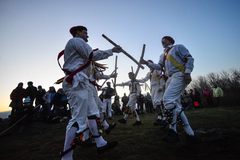 KRISTOPHER RADDER - BRATTLEBORO REFORMER<br /> The Putney Morris Men do a stick dance at the summit of Putney Mountain, in Putney, Vt., during the sunrise to celebrate May Day on May 1, 2018.