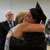 ELODIE REED - FOR THE BERKSHIRE EAGLE Traci Fritz gets a hug from her dental assisting instructor Michelle Racette during the McCann Technical School postsecondary graduation ceremony Thursday evening.