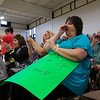 """ELODIE REED - FOR THE BERKSHIRE EAGLE Margherita Hoffman, right, Kerry Wells, center, and Margherita Lombardi, left, cheer on surgical technology graduate and """"soul sister"""" Diane Lewis during at McCann Technical School's postsecondary graduation ceremony Thursday."""