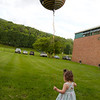 ELODIE REED - FOR THE BERKSHIRE EAGLE Elliana Burdick, 2, waits to give a balloon to her aunt, Breeana Rodriguez, who graduated from McCann Technical School's postsecondary program Thursday.