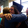 ELODIE REED - FOR THE BERKSHIRE EAGLE Jaclyn Boos hugs friend Summer Daley after Boos graduated from her surgical technology program Thursday.