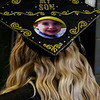 ELODIE REED - FOR THE BERKSHIRE EAGLE Dental assisting graduate Breeana Rodrigue wears her graduate cap decorated for her son, Eugenio, at McCann Technical School's postsecondary graduation ceremony.