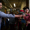 ELODIE REED - FOR THE BERKSHIRE EAGLE Cali Romaniak is bowled over by all the bouquets she received upon graduating from McCann Technical School's postsecondary cosmetology program. Her boyfriend, Cameron Lesure, gives her the final set of flowers.
