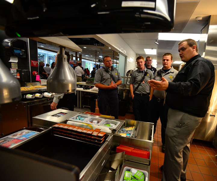 KRISTOPHER RADDER - BRATTLEBORO REFORMER<br /> Michael Mitchell, of the Napoli Group, shows off the new sauce station to members of the Brattleboro Fire Department during a tour of the new McDonald's on Putney Road on Thursday, Sept. 14, 2017.