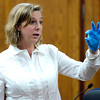 0126KEVIN2.jpg Shelli Friesen, crime scene investigator, holds up a spend shell casing found at the crime scene during Kevin McGregor's trial at the Boulder County Justice Center in Boulder, Colorado January 26, 2012.  McGregor is charged with the murder of Todd Walker in March of 2011. CAMERA/MARK LEFFINGWELL