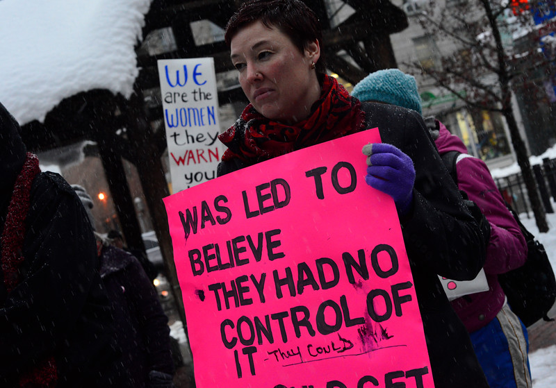 KRISTOPHER RADDER - BRATTLEBORO REFORMER<br /> Brandie Starr, of Brattleboro, and several other women brave the weather to attend the #MeToo Solidarity Rally in Pliny Park, in Brattleboro, that was hosted by the Women's Action Team on Thursday, March 8, 2018.