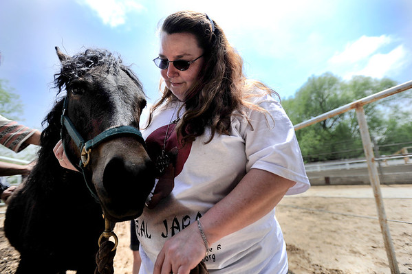 Veteran Dawn Clark talks softly to Ember while she is groomed at Medicine Horse Program in Boulder, Colorado May 16, 2011.  Medicine Horse Program partnered with the Veterans Peace of Mind Project to create Fearless Victory, a program that mixes Veterans suffering from Post Traumatic Stress Disorder (PTSD) with wild horses in a mindful meditation program. CAMERA/Mark Leffingwell
