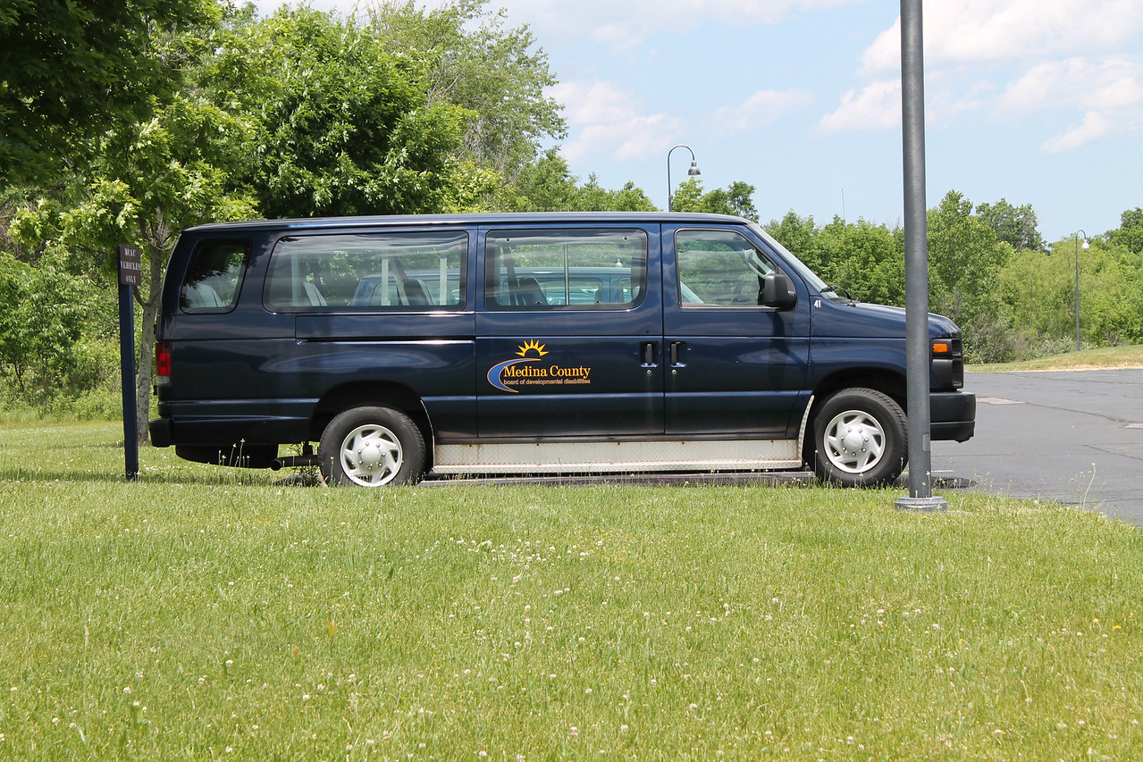 LAWRENCE PANTAGES / GAZETTE A Medina County Board of Developmental Disabilities van is shown at the board's offices at 4691 Windfall Road, Granger Township.