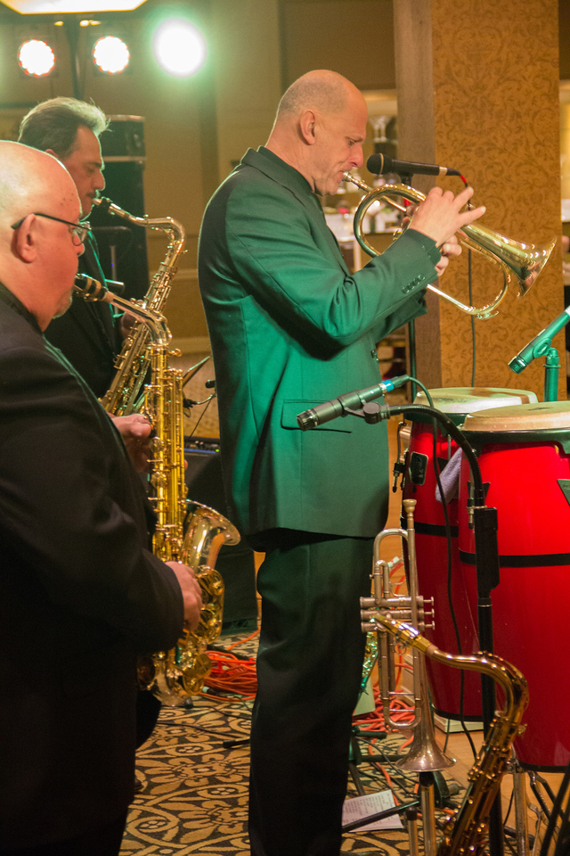 ALEC SMITH / GAZETTE The musical group Raisin' Cain played Saturday night at the 17th Medina County Commissioners' Ball held at Weymouth Country Club. The musicians, from front, were Bob Bruno on saxophone, Ken Zahorcak on flugelhorn and Jim Roberts, also on saxophone.