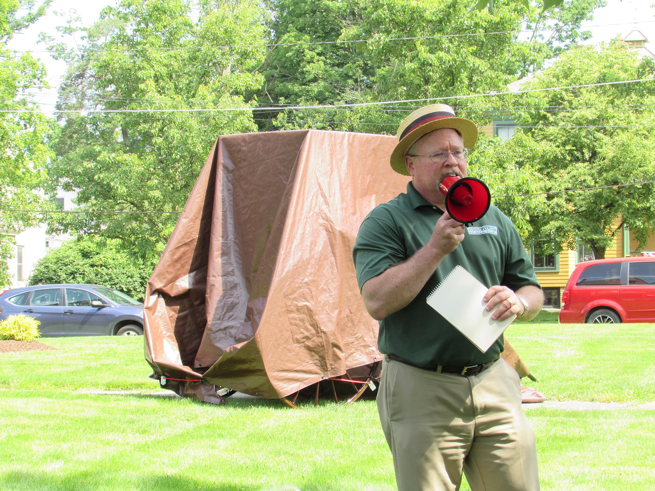 LYDIA MAINZER / SPECIAL TO THE GAZETTE Medina County Historical Society President Brian Feron tells an audience Saturday about the restoration process that took place on an old carriage.