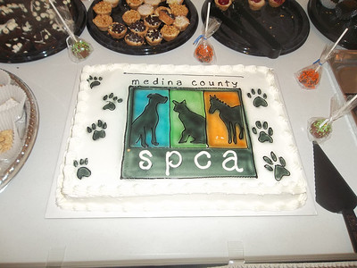 NIKKI RHOADES / GAZETTE A cake with the Medina County SPCA logo added to the festivities of the 13th Animal Affair event Saturday at Diamond Event Center in Brunswick.