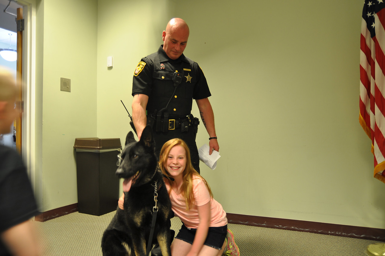 ASHLEY FOX / GAZETTE Kendall Kohler, 10, poses with 17 month-old Apollo and her father, Deputy Dan Kohler. Apollo has lived with the Kohler family for three weeks.