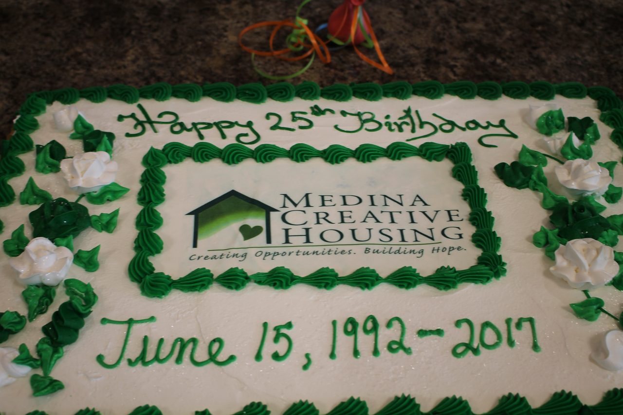 LAWRENCE PANTAGES / GAZETTE A festive cake waits to be enjoyed by attendees last week at Medina Creative Housing's 25th birthday party held at Heartland Community Church, 3400 Weymouth Road, Medina Township.