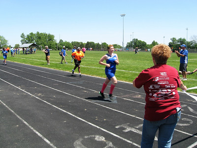 BOB SANDRICK / GAZETTE Rachel Gaishauser, of Wadsworth, in front, and Robin Threats of Canton finished the 200-meter run at the 35th Special Olympics Medina County Invitational at Claggett Middle School Saturday.