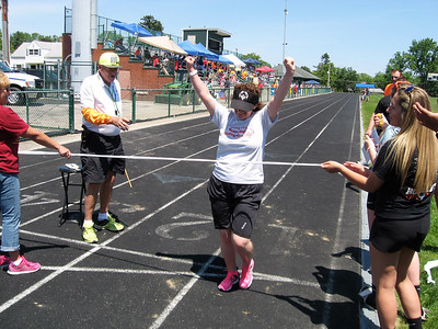 BOB SANDRICK / GAZETTE Elizabeth Opincarne of Mahoning County placed first in the 800-meter walk Saturday at the 35th Special Olympics Medina County Invitational at Claggett Middle School.