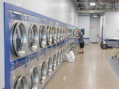 BOB FINNAN / GAZETTE North Court Laundry started the Jackie Smith Laundry Program for Kids, which enables low-income families to wash their clothes for free.