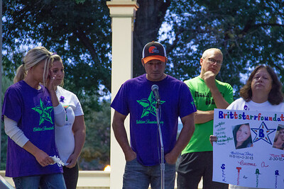 ALEC SMITH / GAZETTE Dennis Martin speaks about the death of his step-children, Brittnee and Marc Johns, who were lost to heroin overdoses. On the right, Darlene Johns, the mother of Brittnee and Marc, and Ashleigh Johns, their sister, listen to him speak.