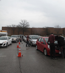 ELIZABETH DOBBINS / GAZETTE Cars line up in the Medina High School parking lot as AAA employees and Medina County Career Center students quickly move through an inspection checklist.
