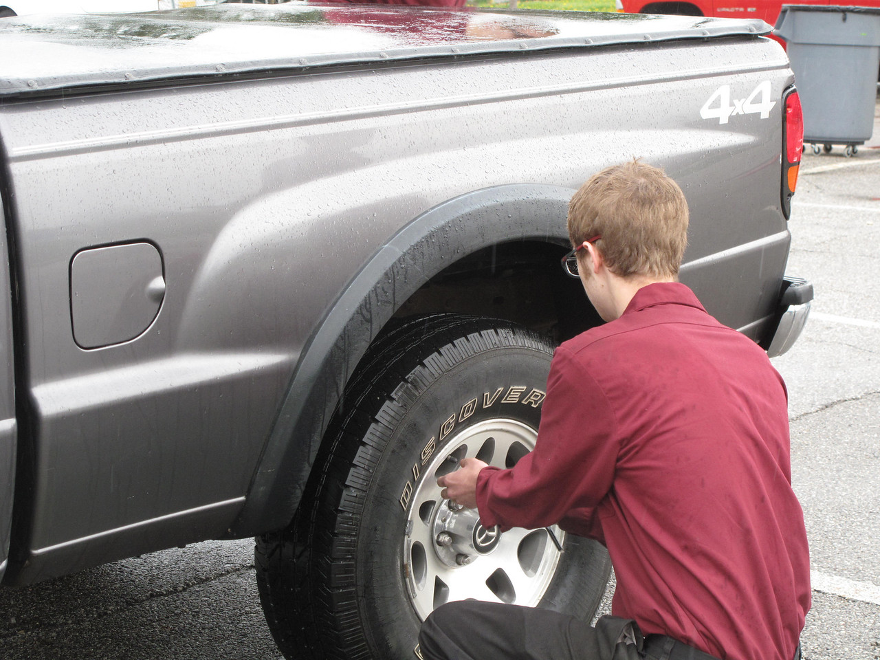 ELIZABETH DOBBINS / GAZETTE Noah Robling of Seville, a Medina County Career Center senior, checks the tire pressure as part of the AAA Ohio Auto Club Vehicle Maintenance Inspection.