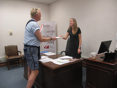 MARINA MALENIC / THE GAZETTE Stephanie Zingaro atLeadership Medina County receives the organization's mail Friday from Greg McClure, who has delivered the Medina Square route for 13 years.