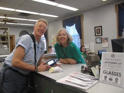 MARINA MALENIC / THE GAZETTE Greg McClure delivers mail to Christy Simmons at the Medina County Clerk of Courts office. He has delivered mail to three generations of the Simmons family during his 30 years in the USPS.