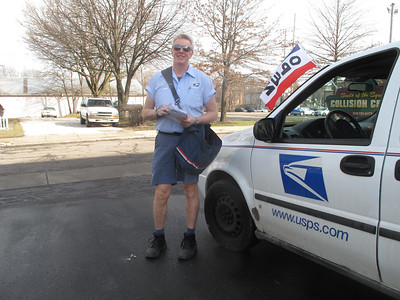 MARINA MALENIC / THE GAZETTE Greg McClure en route to Medina Square on Friday. Monday will be his last day on the job after 30 years with the USPS.
