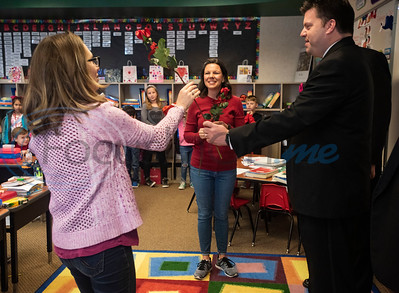 East Texas Men in Harmony JQ Quartet singer John Berry hands a rose to Brook Hill School second grade teacher Toni Collins, left, and Heidi Berry, right, at the school in Bullard on Friday, Feb. 14, 2020. The East Men in Harmony is an all-male chorus and a chapter of the international Barbershop Harmony Society. Each Singing Valentine comes with a love song, a long-stemmed rose and a personalized card, and the Singing Valentines are the biggest fundraiser for the chorus each year to purchase new music and offset travel expenses.