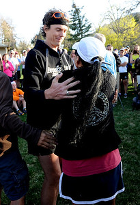 Ultra runner, Scott Jurek, hugs Maria Walton after speaking to the group. A memorial service was held Friday for Boulder  ultrarunner, Micah True, at Chautauqua Park. For photos and a video of the service, go to www.dailycamera.com. Cliff Grassmick / April 6, 2012