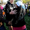 "Ultra runner, Scott Jurek, hugs Maria Walton after speaking to the group.<br /> A memorial service was held Friday for Boulder  ultrarunner, Micah True, at Chautauqua Park.<br /> For photos and a video of the service, go to  <a href=""http://www.dailycamera.com"">http://www.dailycamera.com</a>.<br /> Cliff Grassmick / April 6, 2012"