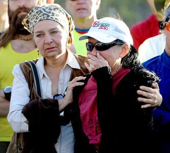Diane Molina, left, comforts, Maria Walton, during the memorial service. Walton was the girlfriend of Micah True. A memorial service was held Friday for Boulder  ultrarunner, Micah True, at Chautauqua Park. For photos and a video of the service, go to www.dailycamera.com. Cliff Grassmick / April 6, 2012