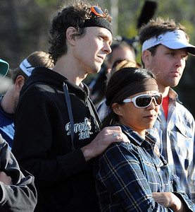 Scott Jurek holds a friend while listening to speakers talk about Micah True. A memorial service was held Friday for Boulder  ultrarunner, Micah True, at Chautauqua Park. For photos and a video of the service, go to www.dailycamera.com. Cliff Grassmick / April 6, 2012