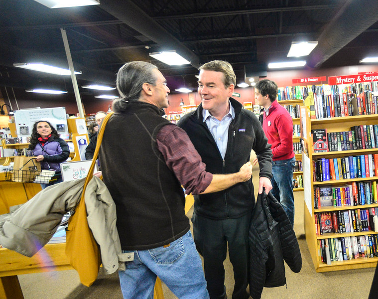 KRISTOPHER RADDER — BRATTLEBORO REFORMER<br /> Democratic presidential candidate Sen. Michael Bennet, D-Colo., shakes hands of people that came to listen to him during a town hall meeting at Toadstool Bookshop, in Keene, N.H., on Friday, Dec. 20, 2019.