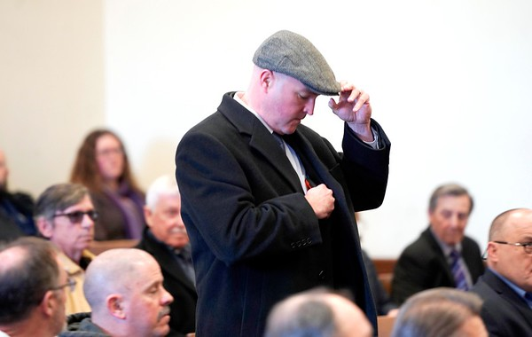 BEN GARVER — THE BERKSHIRE EAGLE<br /> Former Pittsfield Police Officer Michael McHugh enters Berkshire Superior Court before sentencing on charges from an incident that occurred on July 4, 2016, Friday, December 20, 2019.