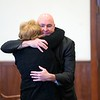 BEN GARVER — THE BERKSHIRE EAGLE<br /> Former Pittsfield Police Officer Michael McHugh hugs a family member in Berkshire Superior Court before sentencing on charges from an incident that occurred on July 4, 2016, Friday, December 20, 2019.