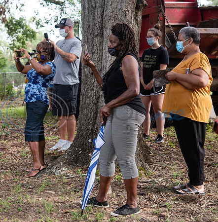 Audrey Turman watches as men from Mineola Public Works work to remove the fence between the segregated Black burial area at Cedars Memorial Gardens Cemetery, formerly Mineola City Cemetery, on Wednesday, July 15, 2020 in Mineola. Turman's husband, grandparents and siblings are buried in the African American section of the cemetery.