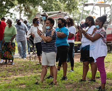 "A crowd watches as men from Mineola Public Works work to remove the fence between the segregated Black burial area at Cedars Memorial Gardens Cemetery, formerly Mineola City Cemetery, on Wednesday, July 15, 2020 in Mineola. The City of Mineola created a public event for people to come watch the historic removal of the fence by Mineola Public Works. A flier touted the event as: ""Removing a fence that separates us. Two cemetery associations working together to remove a boundary and unite our community.""  The two cemetery organizations working together on the fence removal project are Cedars Memorial Garden Association (formally Mineola Cemetery) and City of Mineola Cemetery Association."