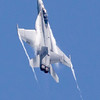 An F/A-18 Hornet climbs during Saturday's air show. Photo by Trevor Cokley