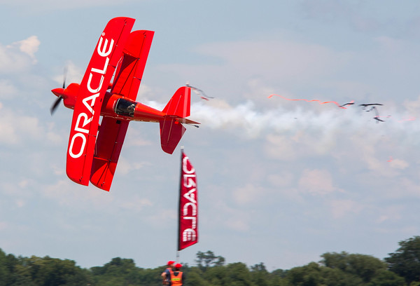 Sean D. Tucker uses his Oracle biplane to cut a ribbon during Saturday's air show. Photo by Trevor Cokley